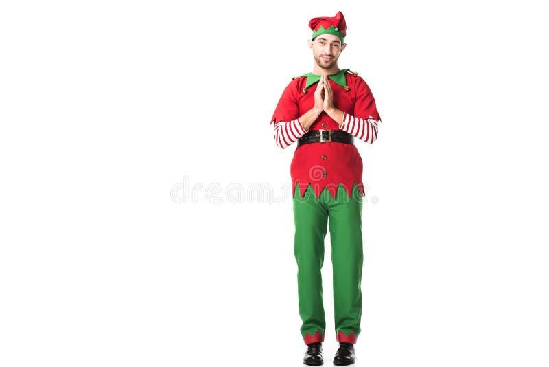 obsługuje w boże narodzenie elfa mienia kostiumowych palmach wpólnie jak zadawala gest i mieć pełny nadziei wyrażenie odizolowywa zdjęcia royalty free