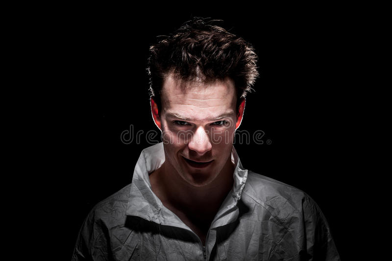Obscure Freaky Smiling Psycho Man royalty free stock photo