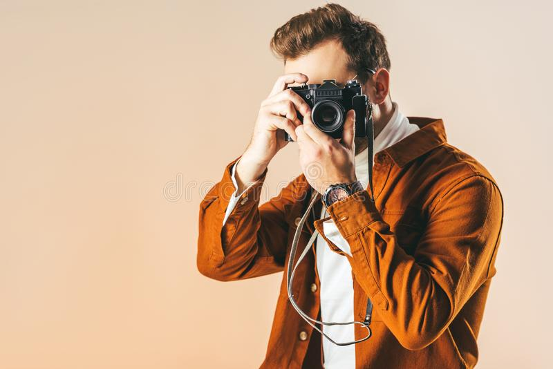 obscured view of fashionable man taking picture on photo camera stock photos