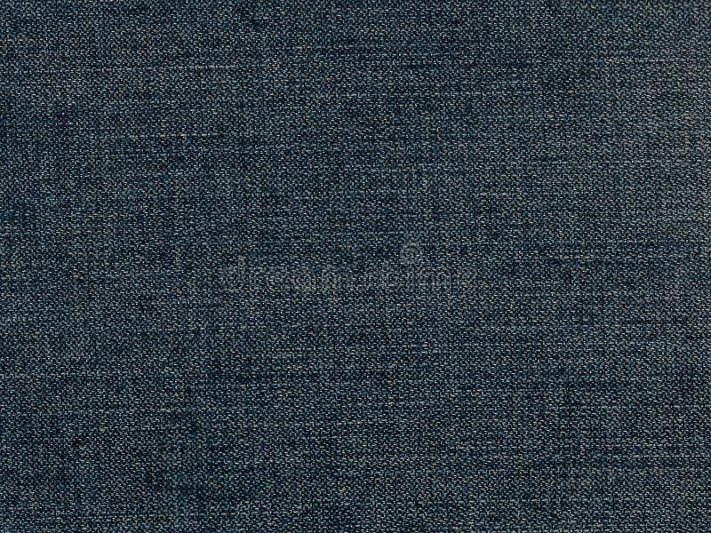Obscuridade das calças de brim - azul imagens de stock