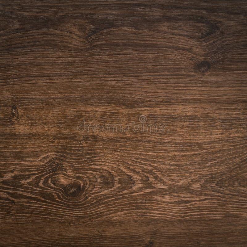 Obscurité en bois de planche de bois de construction de modèle d'abrégé sur lumière de fond de texture photo libre de droits