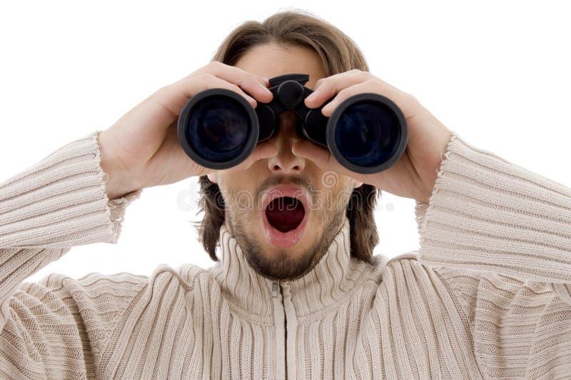 Observação masculina surpreendida com binocular imagens de stock royalty free