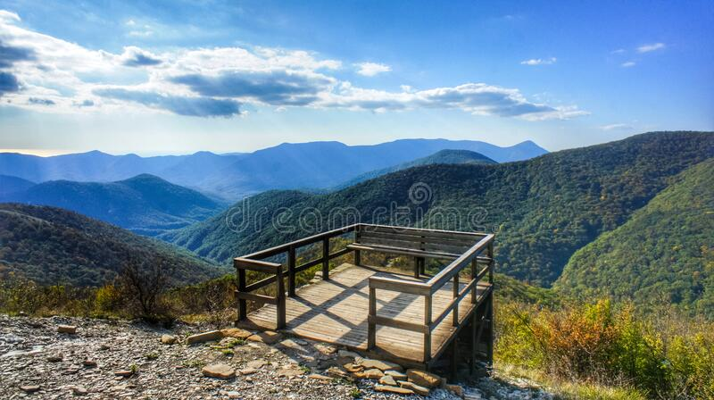 Observation deck made of wood in the mountains. The beginning of the Caucasian mountains. A observation deck made of wood in the mountains. The beginning of the royalty free stock photos