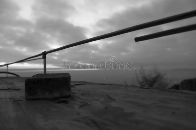 On the observation deck. Waiting for sunrise atop mount tai.The observation deck has iron railings, and a piece of masonry. This is the scene taken at the top royalty free stock images