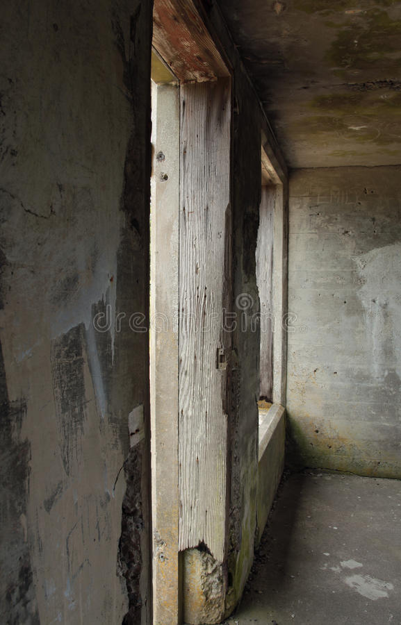 Observation Post Detail. Wooden Door Frame and window shot from inside the observation post at Battery Russell, Fort Stevens Park, Oregon. The Fort was closed stock image