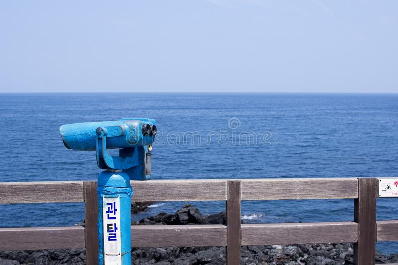 An Observatory overlooking the sea. A telescope on a viewing platform overlooking the beautiful blue sea royalty free stock images