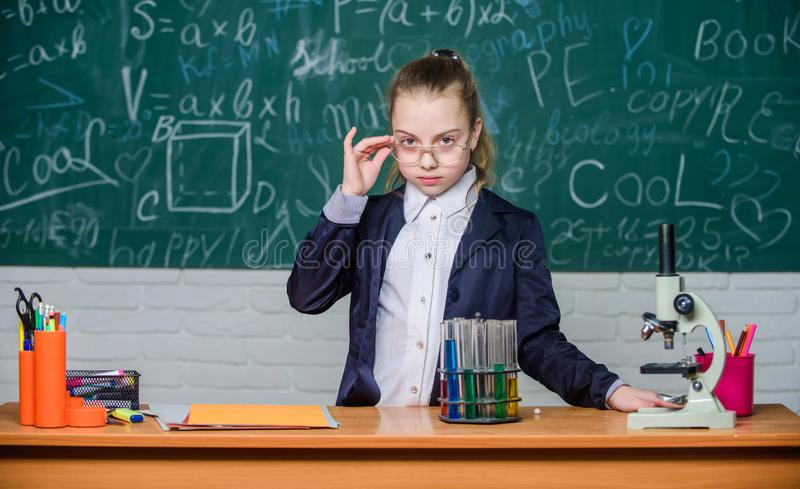 Observe chemical reactions. Chemical reaction much more exciting than theory. Girl working chemical experiment. Educational experiment. Natural science royalty free stock images