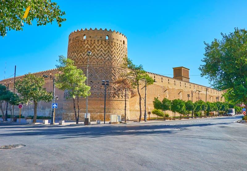 Karim Khan citadel in Shiraz, Iran. Observe historical Karim Khan citadel with circle watchtower, decorated with geometric pattern of relief brick, Shiraz, Iran stock photos