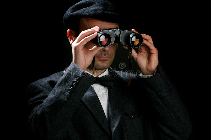 Observer. Old fashioned man look through the binoculars royalty free stock photos