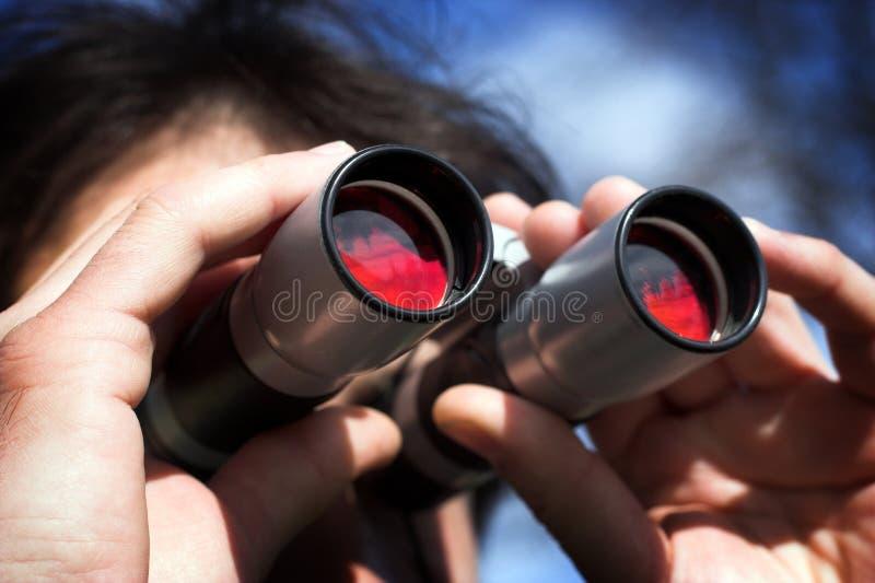 Observer. Man look through the binoculars stock images