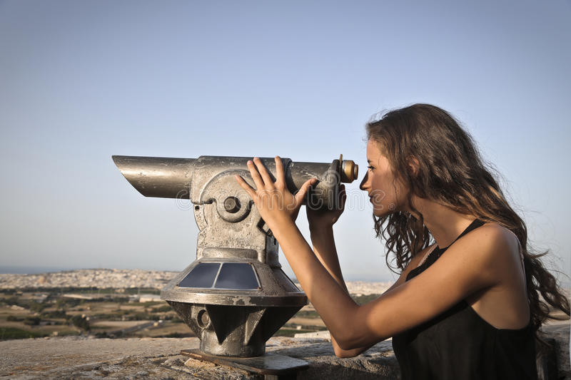 Observing. A girl is observing the horizon royalty free stock photography