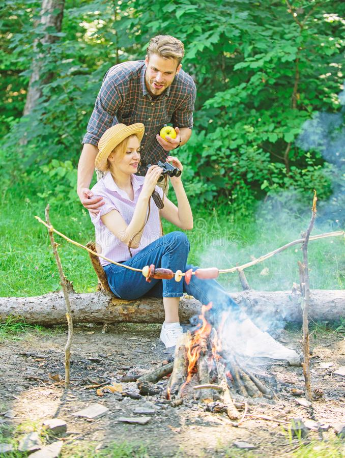 Observing nature concept. Couple ornithologists expedition in forest. Couple enjoy hike in forest observing nature royalty free stock photos