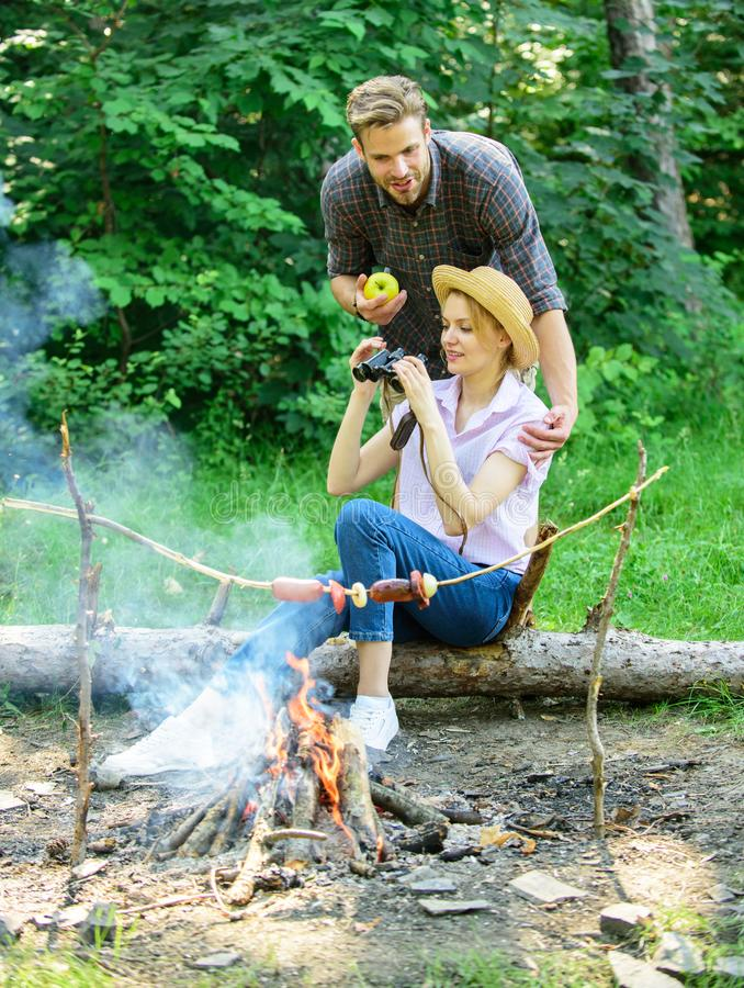 Observing nature concept. Couple ornithologists expedition in forest. Couple enjoy hike in forest observing nature stock images