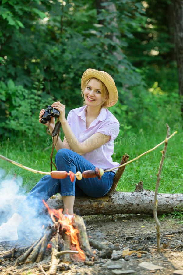 Observing nature concept. Girl ornithology expedition in forest. Girl enjoy hike in forest observing nature. Her hobby stock photos