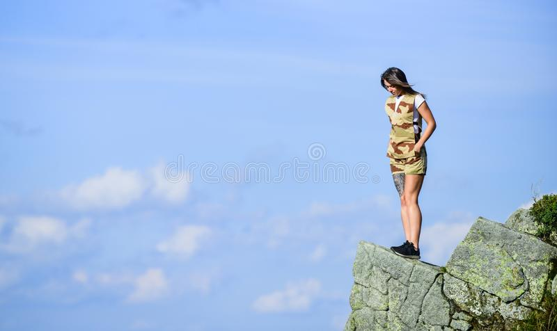 Observing point. Brave girl dangerous cliff. Suicidal mood. Brave and fearless. Depression concept. Brave woman stand. Alone in high mountains blue sky stock image