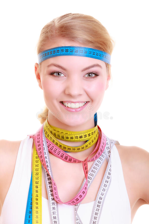 Obsessed fitness woman with a lot of colorful measure tapes royalty free stock image