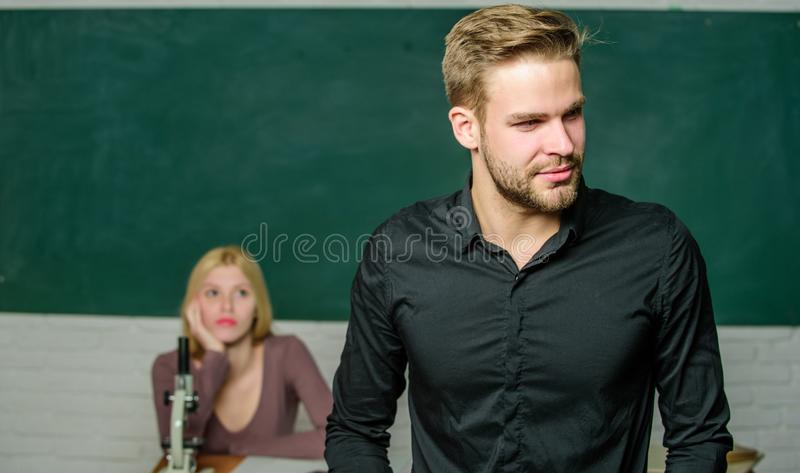 Obsessed with knowledge. Teacher of her dreams. Handsome teacher. School and college education. Successfully graduated. Youth mentoring. Man well groomed stock image
