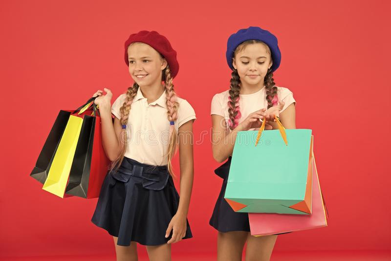 Obsessed with shopping and clothing malls. Shopaholic concept. Signs you are addicted to shopping. Kids cute schoolgirls stock photos