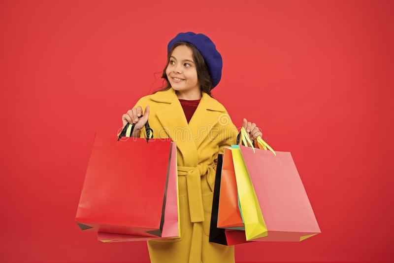 Obsessed with shopping. Girl cute kid hold shopping bags. Get discount shopping on birthday holiday. Nice purchase stock photo
