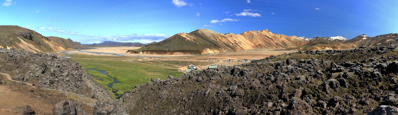 Obsidian Lavafield, Hot Spring and Colourful Mountains at Landmannalaugar, Central Iceland, Panorama. Panoramic views of the beautiful landscape at royalty free stock image