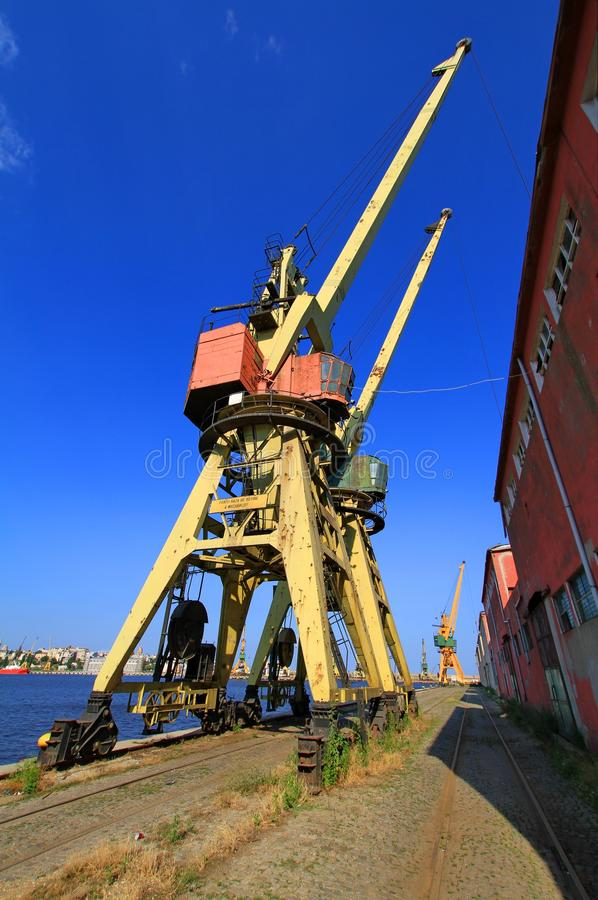 Download Obsolete Cranes In The Dockyard Stock Photo - Image: 32873866