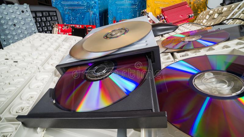Compact discs and keyboards in a heap of old computer parts. E-waste sorting and recycling royalty free stock photos
