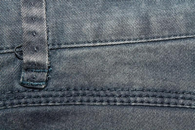 Obsolete gray jeans laces Denim texture, macro background for web site or mobile devices royalty free stock photography