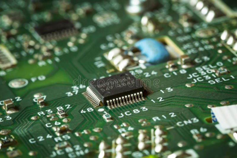 Obsolete green computer board, technology detail stock photography