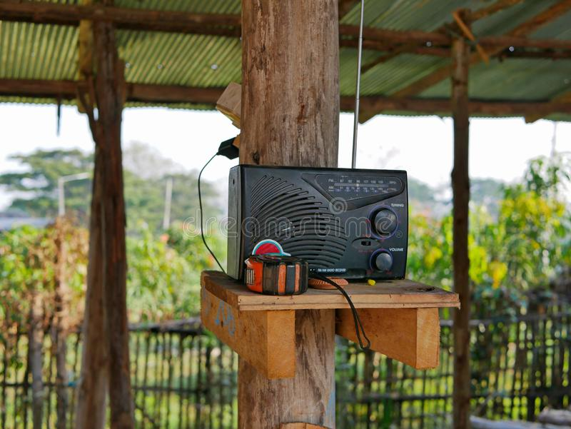 An obsolete radio receiver being used at home in a rural area of Thailand stock photo
