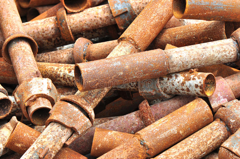 Obsolete steel pipes. Rusty steel construction stuffs closeup stock photos