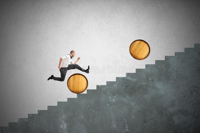 Obstacles. Concept of difficulty with businessman that jumps obstacles stock photo