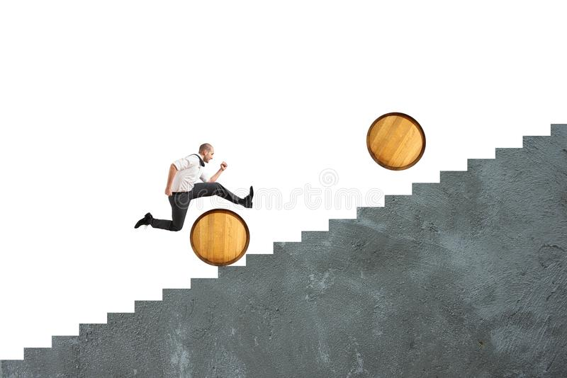 Obstacles. Concept of difficulty with businessman that jumps obstacles stock image