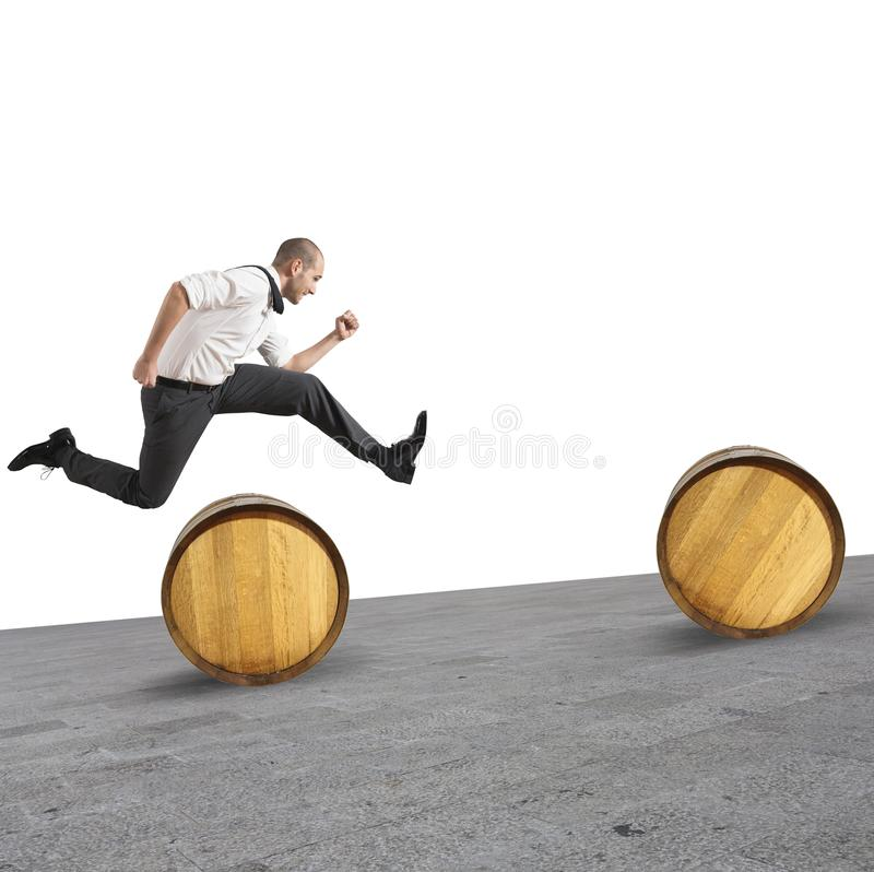 Obstacles. Concept of difficulty with businessman that jumps obstacles royalty free stock image