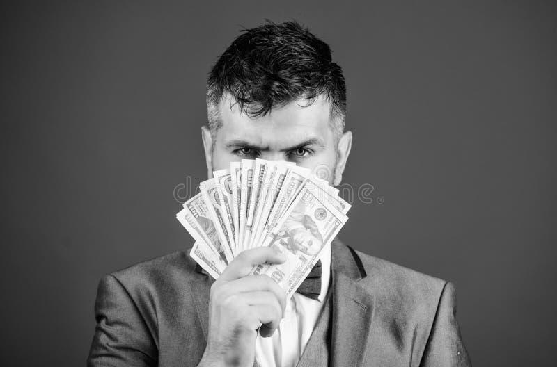 Obtenha o dinheiro do dinheiro fácil e rapidamente cheiro do dinheiro Empréstimos de dinheiro fáceis Pilha formal da posse do ter imagens de stock royalty free