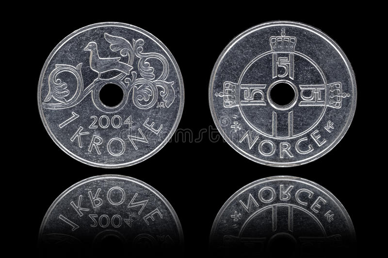 Obverse and reverse of one Norwegian krone coin. On black background stock images