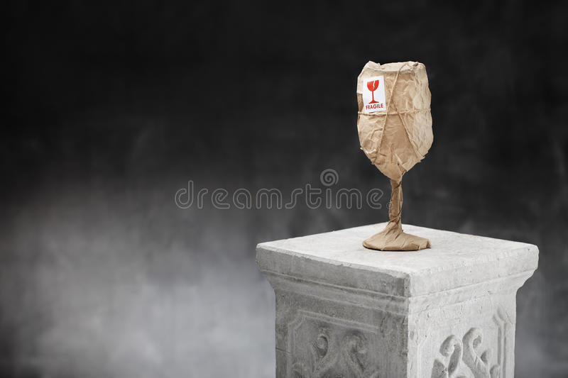 Obviously Fragile. An obviously fragile object wrapped in paper and with a fragile sticker royalty free stock photography