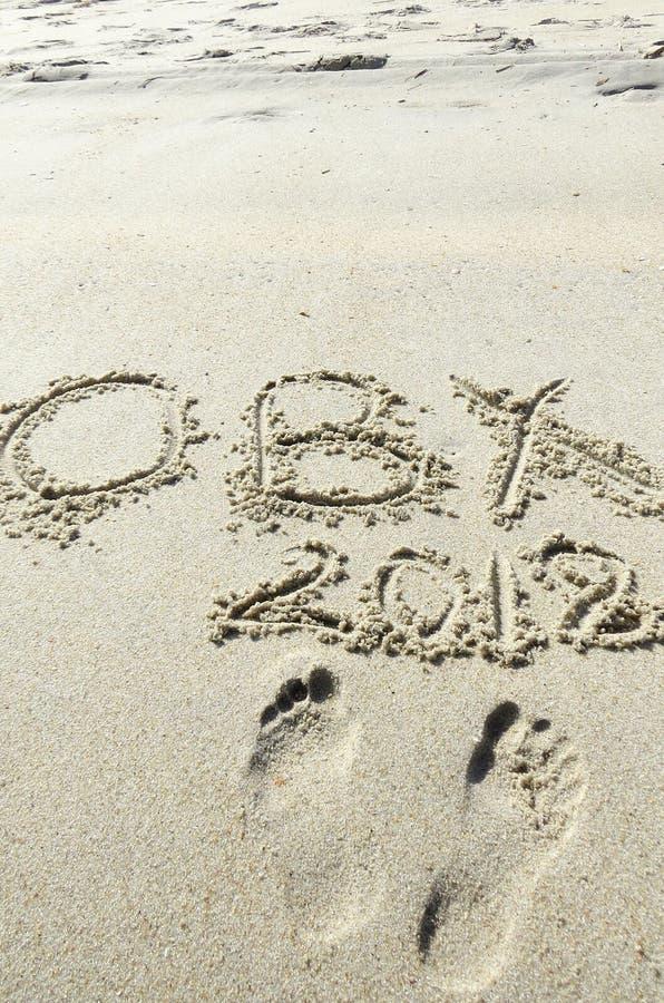 OBX 2018 escrito na areia fotos de stock royalty free