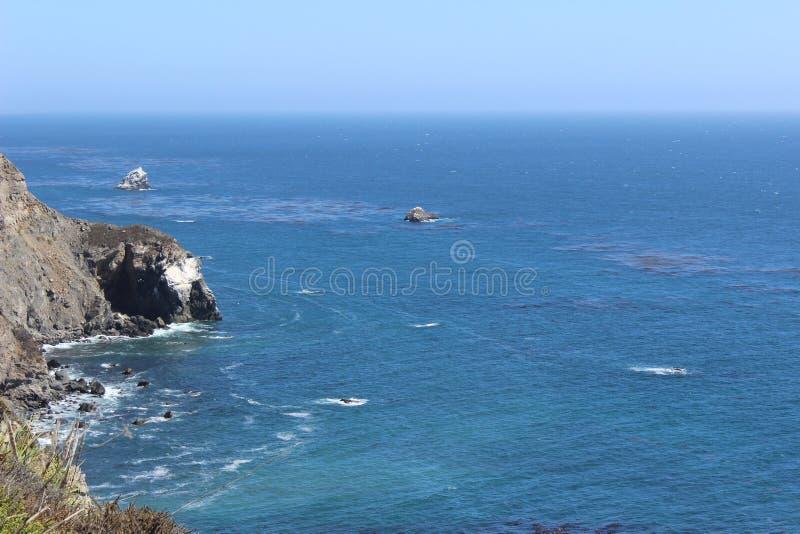 Océan bleu de tourbillonnement photographie stock libre de droits