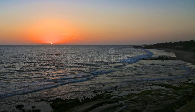 Océan de coucher du soleil photo libre de droits