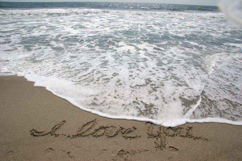 Océano SeaFooam y arena imagen de archivo