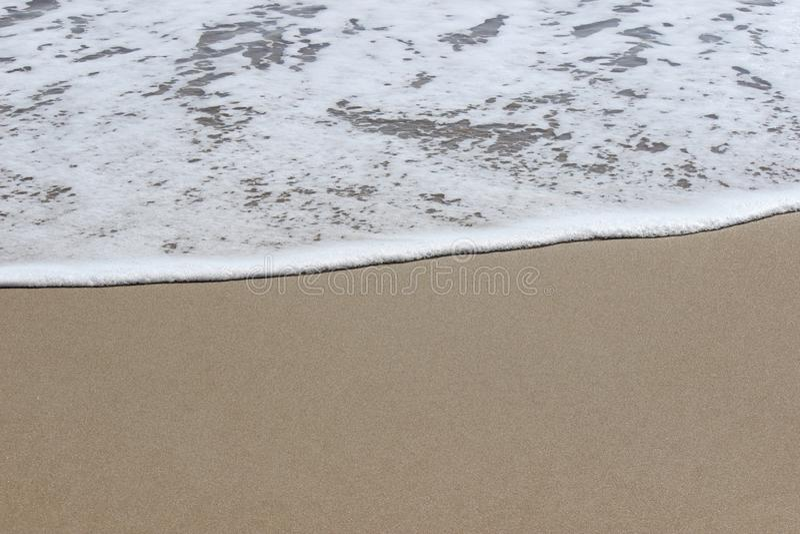 Océano y arena fotos de archivo