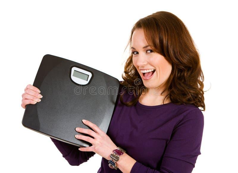 Ocasional: Mulher entusiasmado para a perda de peso fotos de stock royalty free