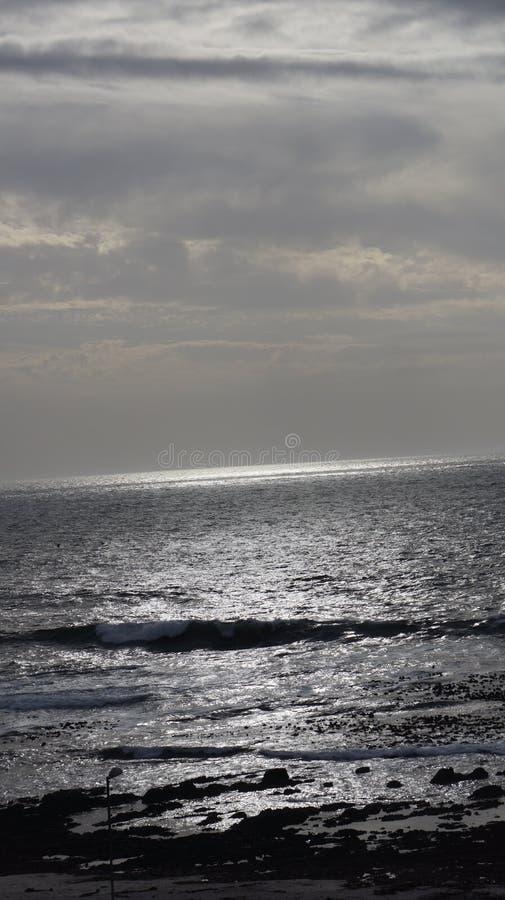Ocaso en el océano imágenes de archivo libres de regalías