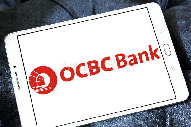 OCBC Bank logo. Logo of OCBC Bank on samsung tablet. OCBC Bank is a publicly listed financial services organisation royalty free stock photography