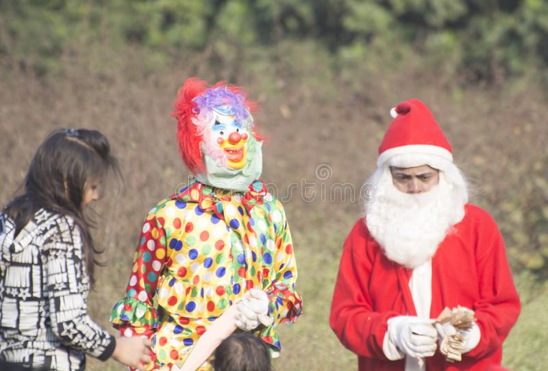 On the occassion of Christmas day little children have dressed up in Santa Clauses attire stock photo