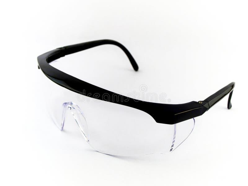 Occhiali di protezione di sicurezza su priorità bassa bianca immagine stock libera da diritti