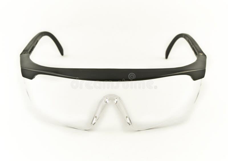 Occhiali di protezione di sicurezza su priorità bassa bianca immagine stock