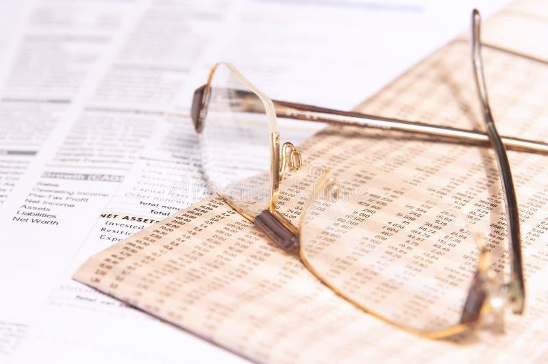 Occhiali e commercio immagine stock libera da diritti