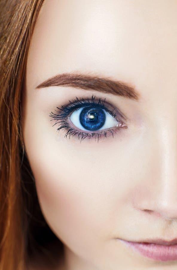 Occhio della donna e spazio cosmico fotografia stock