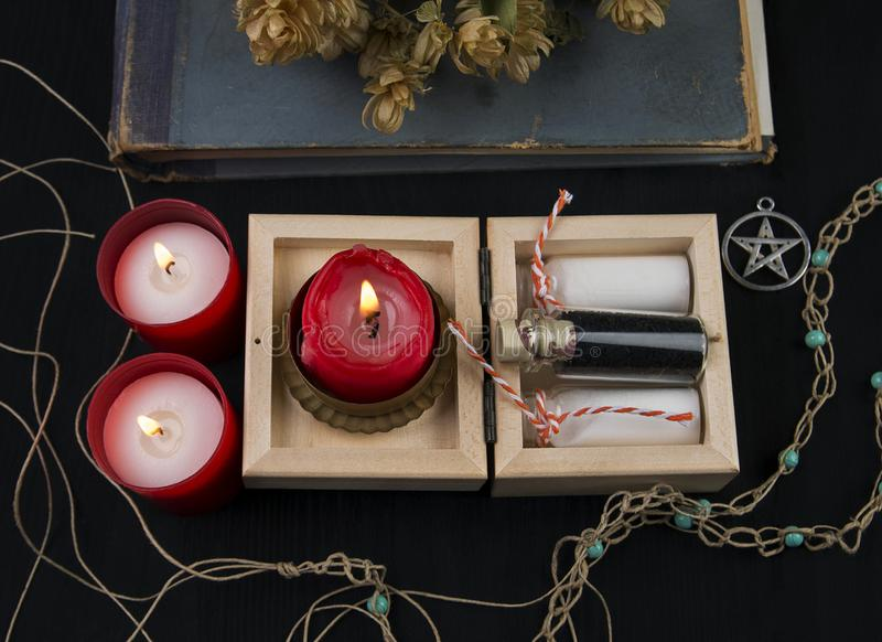 Occult altar with hops, candles and potion royalty free stock photography